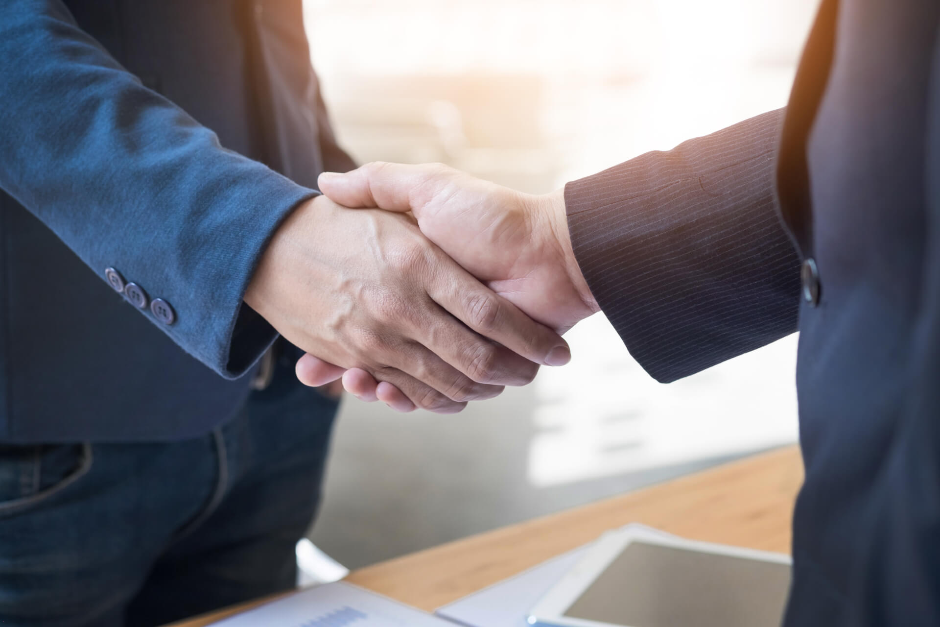 two-confident-business-man-shaking-hands-during-meeting-office-success-dealing-greeting-partner-concept (1) (1)